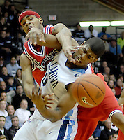 St. John's guard D.J. Kennedy, left, blocks the shot of Villanova forward Antonio Pena, right, in the second half of an NCAA basketball game Sunday, Jan. 18, 2009 in Villanova, Pa. Villanova defeated St. John's 76-57. (AP Photo/Bradley C Bower)