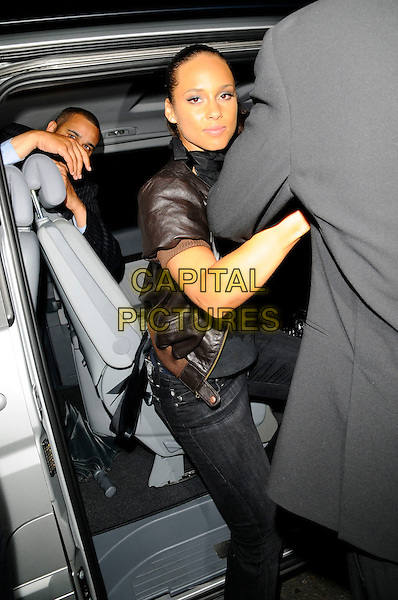 ALICIA KEYS .Departures - The Black Ball UK,.St. John's Church, Smith Square, London, England, July 10th 208..half length getting into car brown leather jacket short cropped sleeves .CAP/CAN.©Can Nguyen/Capital Pictures