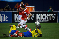 Chile's player Alexis Sanchez ( C) fights for the ball with Ecuador's players Fernando Menses ® and Antonio Valencia during their friendly match at the Citi-Field Stadium in New York, August 15, 2012. Photo by Eduardo Munoz Alvarez / VIEW.