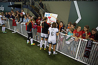 Portland, Oregon - Wednesday September 7, 2016: Portland Thorns FC forward Mallory Weber (26, left), Portland Thorns FC midfielder Dagny Brynjarsdottir (11, center) and Portland Thorns FC midfielder Meleana Shim (6, right) sign autographs for fans after a regular season National Women's Soccer League (NWSL) match at Providence Park.