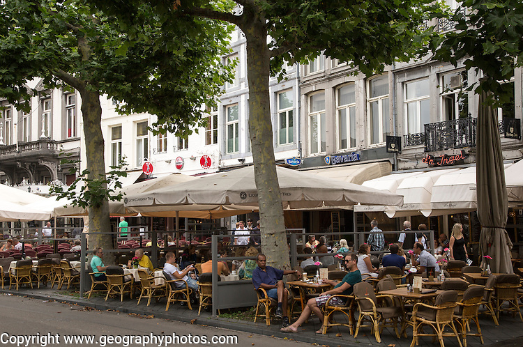 People sitting outside cafes in Vrijthof square, Maastricht, Limburg province, Netherlands,