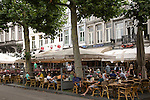 People sitting outside cafes in Vrijthof square, Maastricht, Limburg province, Netherlands,