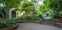 Shade garden with stone sitting wall and steps, Marin Art and Garden Center, Ross, California