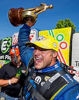 Jun 7, 2015; Englishtown, NJ, USA; NHRA funny car driver Matt Hagan celebrates after winning the Summernationals at Old Bridge Township Raceway Park. Mandatory Credit: Mark J. Rebilas-