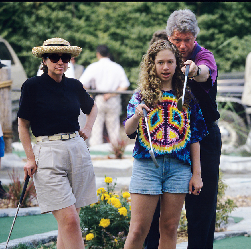 Bill & Hillary Clinton play miniature golf with daughter Chelsea during a Presidential vacation on the Massachusetts island of Martha's Vineyard.