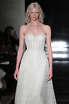 Model walks runway in a strapless re-embroidered lace A-line gown with lace up back, from the Reem Acra Spring 2017 bridal collection, during New York Bridal Fashion Week Spring Summer 2017, on April 15, 2016.