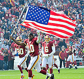 Washington Redskins quarterback Robert Griffin III (10) carries an American Flag during the pre game introductions for the game against the Philadelphia Eagles at FedEx Field in Landover, Maryland on Sunday, November 18, 2012.  Cornerback D.J. Johnson (30) and punter Sav Rocca (6) look on..Credit: Ron Sachs / CNP