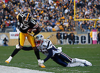 PITTSBURGH, PA - OCTOBER 30:  Mike Wallace #17 of the Pittsburgh Steelers is tackled by Devin McCourty #32 of the New England Patriots after catching a pass during the game on October 30, 2011 at Heinz Field in Pittsburgh, Pennsylvania.  (Photo by Jared Wickerham/Getty Images)