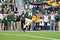 Baylor quarterback Bryce Petty (14) points for toward the end zone while rushing during NCAA football game, Saturday, November 01, 2014 in Waco, Tex. Baylor defeated Kansas 60-14. (Mo Khursheed/TFV Media via AP Images)