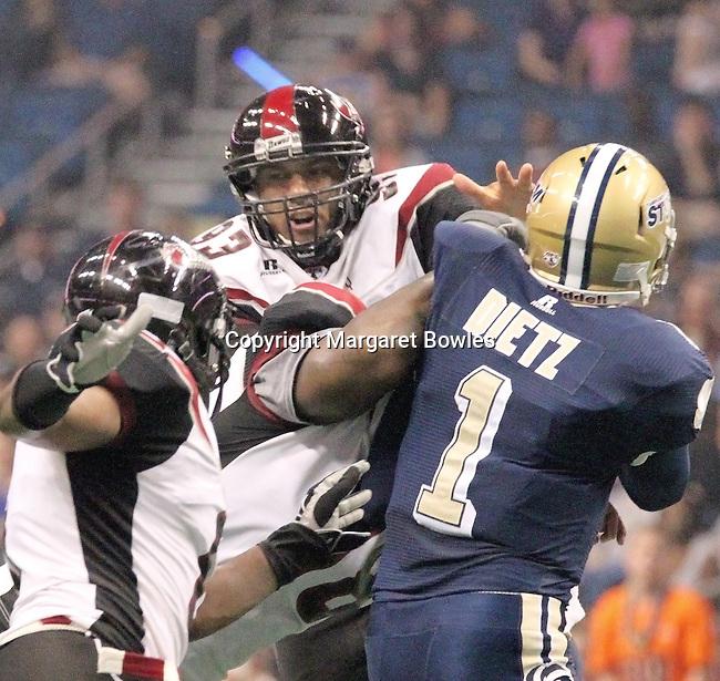 05 June 2010: Oklahoma City's defense pressures Tampa Bay quarterback Brett Dietz. The Tampa Bay Storm defeated the Oklahoma City Yard Dawgz 50-48 at the St. Pete Forum in Tampa, Florida
