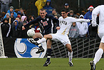 13 December 2009: Akron's Zarek Valentin (2) and Virginia's Will Bates (25). The University of Virginia Cavaliers defeated the University of Akron Zips 3-2 on penalty kicks after playing to a 0-0 overtime tie at WakeMed Soccer Stadium in Cary, North Carolina in the NCAA Division I Men's College Cup Championship game.