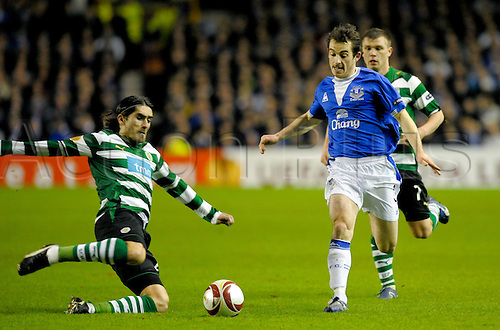2010 Everton v Sporting Feb 16, Goodison Park..Leighton Baines of Everton IS TACKELD BY PEDRO MENDES OF Sporting Lisbon. Photo: Alan Edwards/Actionplus. - Editorial Use