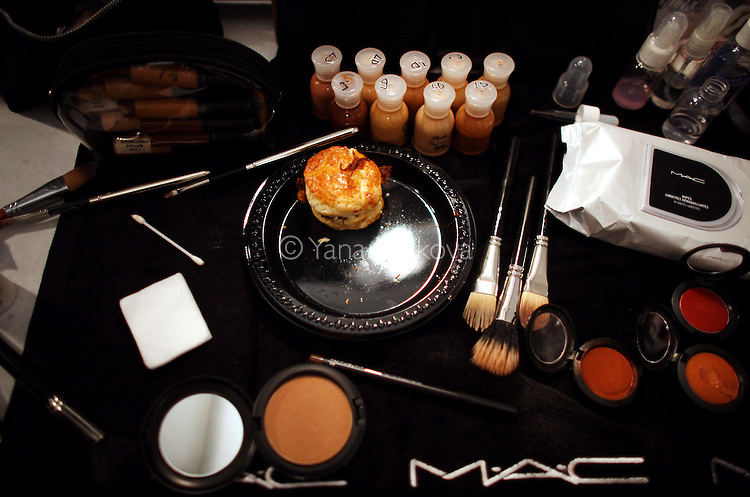 Food and make-up mix backstage as models prepare for the Herve Leger show at the Bryant Park tents on Sunday, September 13, 2009 during Spring 2010 Mercedes-Benz Fashion Week in Manhattan, New York.