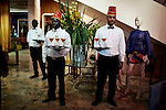 CAPE TOWN, SOUTH AFRICA - JULY 26: Waiters wait to serve drinks to guests before an installation show at the new Klûk CGDT flagship store during Mercedes-Benz Fashion Week on July 26, 2014, in Cape Town, South Africa. Klûk CGDT, created by the designers Malcolm KLûK and Christiaan Gabriel Du Toit. The elite of Cape Town came out for the launch of the store and the late night party. (Photo by Per-Anders Pettersson)