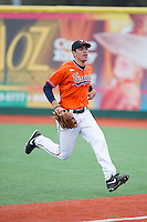 Virginia Cavaliers right fielder Adam Haseley (7) chases after a foul fly ball during the game against the Seton Hall Pirates at The Ripken Experience on February 28, 2015 in Myrtle Beach, South Carolina.  The Cavaliers defeated the Pirates 4-1.  (Brian Westerholt/Four Seam Images)