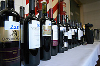 Bottles lined up and numbered with identity numbers for the blind tasting at the Catador in Argentina. Catad'Or Wine Competition, Buenos Aires Argentina, South America