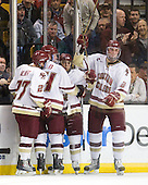 Patch Alber (BC - 27), Bill Arnold (BC - 24), Steven Whitney (BC - 21), Brian Dumoulin (BC - 2) - The Boston College Eagles defeated the Northeastern University Huskies 5-4 in their Hockey East Semi-Final on Friday, March 18, 2011, at TD Garden in Boston, Massachusetts.