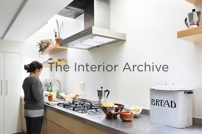Anna Myat prepares the family tea in the open plan kitchen