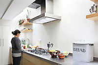 Anna Myat prepares the family tea in the open plan kitchen
