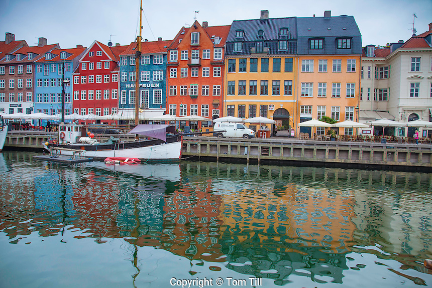 Colorful buildings in Nyhavn,<br />  Copenhagen, Denmark,<br /> !7th century waterfront village <br /> Canals reflect multi-colored storefronts