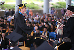 Greyson Friend dances across the stage to Interim President Chester Burton during the Western Nevada College commencement at the Pony Express Pavilion, in Carson City, Nev., on Monday, May 19, 2014. <br /> Photo by Cathleen Allison/Nevada Photo Source