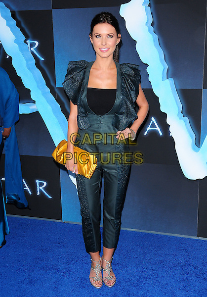AUDRINA PATRIDGE.The Twentieth Century Fox World Premiere of Avatar held at The Grauman's Chinese Theatre in Hollywood, California, USA. .December 16th, 2009.full length catsuit jumpsuit hand on hip black ruffle ruffles silver sandals gold yellow clutch bag grey gray green.CAP/RKE/DVS.©DVS/RockinExposures/Capital Pictures.