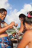 FRENCH POLYNESIA, Raiatea Island. Local kids swimming and playing along the coast.
