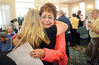 Mimi Shalitta (right) of Glenside, Pennsylvania is overcome with emotion as she is hugged by a participant during a butterfly release and memorial at Kirk and Nice Funeral Home Sunday May 8, 2016 in Feasterville, Pennsylvania.  (Photo by William Thomas Cain)