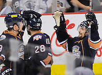 Oklahoma City Barons players celebrate a goal during the second period of an AHL hockey game, Friday, May 11, 2012, in San Antonio. (Darren Abate/pressphotointl.com)