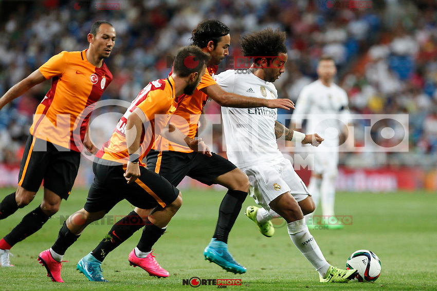 Real Madrid´s Marcelo Vieira faces Galatasaray´s players during Santiago Bernabeu Trophy match at Santiago Bernabeu stadium in Madrid, Spain. August 18, 2015. (ALTERPHOTOS/Victor Blanco)