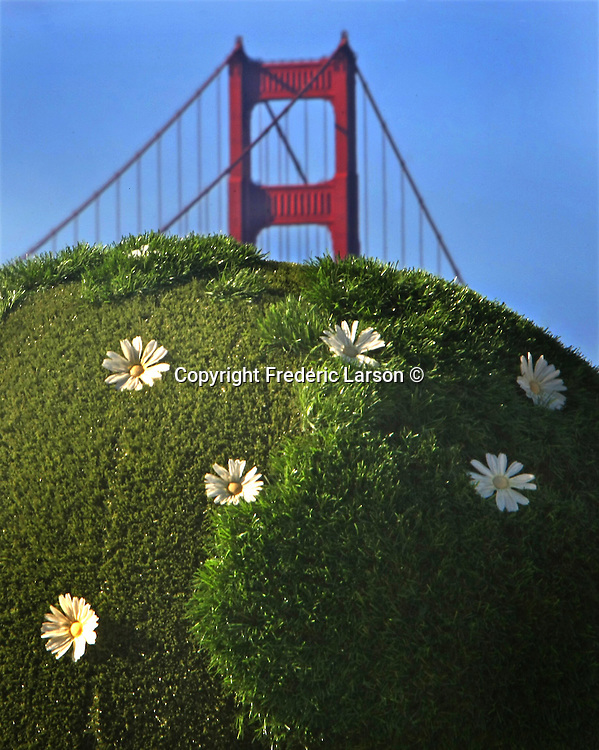 The Golden Gate Bridge and a green global art piece at Crissy Field in Presido of San Francisco, California.