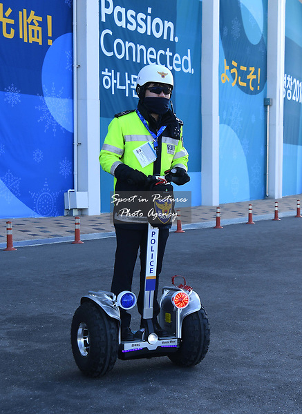 Policeman on a segway patrols around the park. Around the Gangneung Olympic park. Pyeongchang2018 winter Olympics. Gangneung. Republic of Korea. 12/02/2018. ~ MANDATORY CREDIT Garry Bowden/SIPPA - NO UNAUTHORISED USE - +44 7837 394578