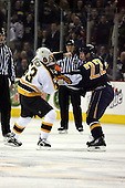 February 17th 2007:  Jeremy Reich (53) of the Boston Bruins and Adam Mair (22) of the Buffalo Sabres settle things on the ice at HSBC Arena in Buffalo, NY.  The Bruins defeated the Sabres 4-3 in a shootout.
