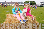 Tegan O'Sullivan, Betty the dog and Ava Raymond (all from Tralee) taking a break after the Dog Show and Terrier Race at the Fenit Seabreeze Festival on Sunday.