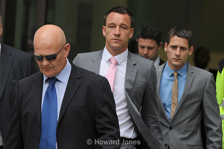 John Terry (centre) leaves Westminster Magistrates' Court on the first day of his trial accused of a racially aggravated public order offence. London 9th July 2012
