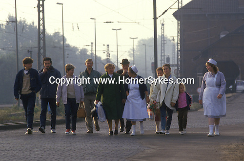 Friedland refugee camp West Germany. 1980's Polish refugees walk to the train station to taake a train to a new life in western Europe.