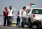 Activists of the Palestine 194 campaign distribute flags and leaflets to motorists in order to drum for Palestine to become the 194th state recognised by the UN, in the West bank town of Ramallah, on 13 September 2011. The United States has already said it would veto such a request for Palestinian statehood if it comes before a vote in the UN Security Council later this September. Israel is also opposed, although the Palestine 194 campaign claims has the support of 125 countries - more than a majority of world states. Photo by Issam Rimawi