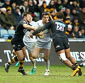 January 7th 2018, Ricoh Arena, Coventry, England;  Aviva Premiership rugby, Wasps versus Saracens;   Alex Lozowski (Saracens)  is tackled by Guy Armitage and Rob Miller of Wasps during the Aviva Premiership (Round 13) match between Wasps and Saracens rfc at the Ricoh Stadium