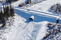 Aliy Zirkle runs through a road-crossing culvert as she leaves the Galena checkpoint during the 2017 Iditarod on Friday afternoon March 10, 2017.<br /> <br /> Photo by Jeff Schultz/SchultzPhoto.com  (C) 2017  ALL RIGHTS RESERVED
