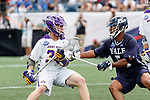 Tyler Warner  (#5) defends against Sean Eccles (#38) as Yale defeats UAlbany 20-11 in the NCAAA semifinal game at Gillette Stadium, May 26.