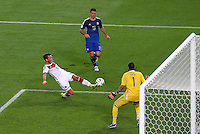 Mario Goetze of Germany scores the winning goal past Argentina goalkeeper Sergio Romero in extra time to win his side the 2014 FIFA World Cup