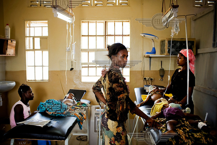 Mothers with their children suffering from malaria at MSF (Medecins sans Frontieres) Gondama hospital in Bo.
