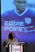 Karen Pope introduces her brother Hall of Fame inductee Eddie Pope (not pictured) during the 2011 National Soccer Hall of Fame induction ceremony in Foxborough, MA, on June 04, 2011.