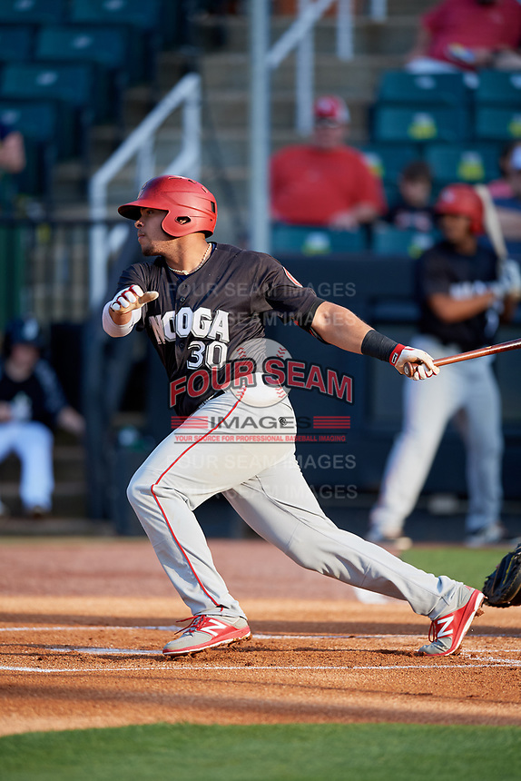 Chattanooga Lookouts first baseman Jonathan Rodriguez (30) follows through on a swing during a game against the Jackson Generals on April 29, 2017 at The Ballpark at Jackson in Jackson, Tennessee.  Jackson defeated Chattanooga 7-4.  (Mike Janes/Four Seam Images)