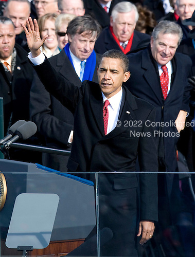 Washington, DC - January 20, 2009 -- United States President Barack Obama waves to the crowd after delivering his Inaugural Address after taking the oath of office as the 44th President of the United States in Washington, DC, USA, 20 January 2009. Obama defeated Republican candidate John McCain on Election Day 04 November 2008 to become the next U.S. President.Credit: Matthew Barrick - CNP