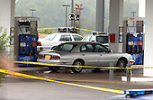 """Fredericksburg, VA - October 11, 2002 -- The Gray Buick Park Avenue is still at the pump at the Fredericksburg Exxon Station this morning.  Police have not determined if this shooting is connected with the """"Beltway Sniper"""" shootings that have terrorized the National Capital Area.<br /> Credit: Ron Sachs / CNP<br /> (RESTRICTION: NO New York or New Jersey Newspapers or newspapers within a 75 mile radius of New York City)"""