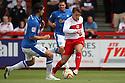 Luke Freeman of Stevenage takes on George Boyd of Peterborough. Stevenage v Peterborough - PSF - Lamex Stadium, Stevenage . - 4th August, 2012. © Kevin Coleman 2012