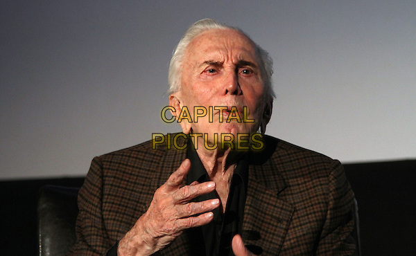 "KIRK DOUGLAS .2011 TCM Film Festival Presents an Evening with Kirk Douglas with A Q&A and A screening of ""Spartacus"" Held At The Grauman Chinese Theatre, Hollywood, California, USA..April 29th, 2011.headshot portrait brown check suit   hand.CAP/ADM/KB.©Kevan Brooks/AdMedia/Capital Pictures."