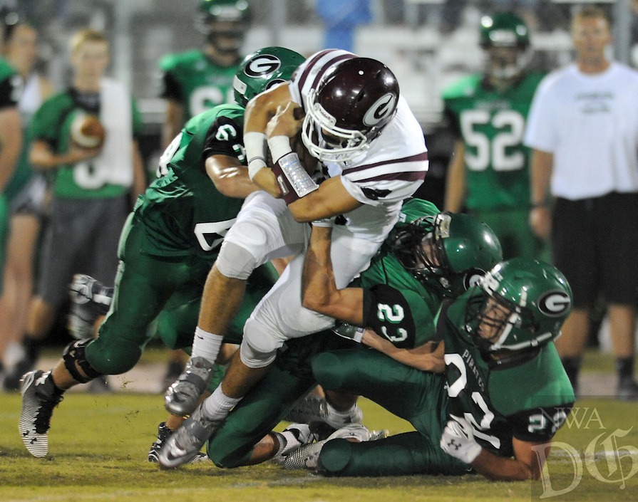 NWA Democrat-Gazette/ANDY SHUPE<br /> Paycen Dennis (23) of Greenland tackles C.J. Taylor of Gentry Friday, Sept. 18, 2015, during the first half of play at Jonathan Ramey Memorial Stadium in Greenland. Visit nwadg.com/photos to see more photographs from the game.
