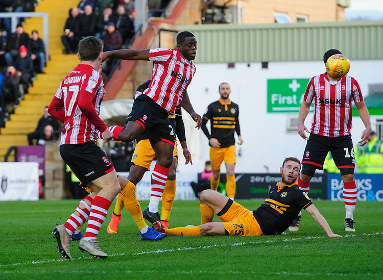 Lincoln City's John Akinde scores the opening goal<br /> <br /> Photographer Chris Vaughan/CameraSport<br /> <br /> The EFL Sky Bet League Two - Lincoln City v Newport County - Saturday 22nd December 201 - Sincil Bank - Lincoln<br /> <br /> World Copyright © 2018 CameraSport. All rights reserved. 43 Linden Ave. Countesthorpe. Leicester. England. LE8 5PG - Tel: +44 (0) 116 277 4147 - admin@camerasport.com - www.camerasport.com
